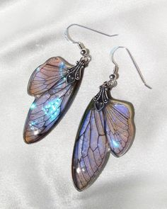 wings and dress in purple on a purple leaf Floriane the fairy of nature earrings