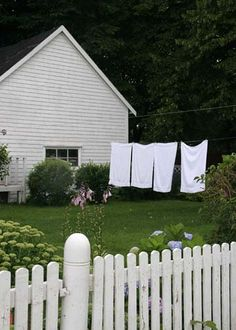No little white fence where I grew up, but we did have double wire clothes line used every week. Hated pinning clothes to the line then, and I still hate doing laundry today.