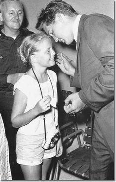 Elvis Presley an another little fan  one lucky little girl