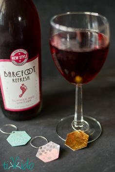I made these pretty, reusable wine charms out of scrapbook paper and gel nail polish!  Perfect for claiming my glass of Barefoot Refresh spritzer. #BarefootRefresh #SpritzerSeason