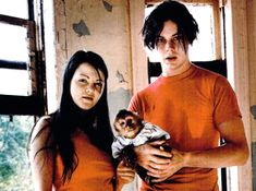 Jack White flicks his cigarette ash into a glass of water. He and Meg White are sitting on a couch in an überswanky hotel room in downtown Chicago, trying to Meg White, Jack White, Music Love, Listening To Music, The White Stripes, Mtv Movie Awards, Kid Poses, Rock Groups, Shake Hands