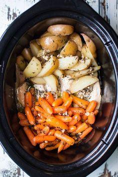 Slow Cooker Garlic Butter Chicken and Veggies: chicken, carrots, Yukon gold potatoes, butter, garlic, salt, pepper, thyme, parsley