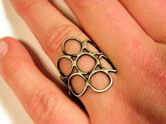 Sterling silver circles ring adjustable art ring silversmith. via Etsy.
