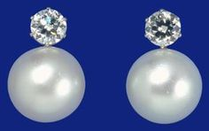 THE LADIES OF DEVONSHIRE EARRINGS Purchased by the Ladies of Devonshire, headed by Lady Clinton, as a wedding present for Princess May of Teck (later Queen Mary) and made to match a pearl and diamond necklace presented by the 'Ladies of England'. The earrings were a wedding present from Queen Mary to Princess Elizabeth in 1947.
