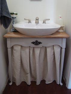 one way to hide a hideous builder cheap pedestal sink throw a skirt on it