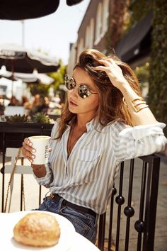 Striped button downs, jeans and a great pair of sunglasses.