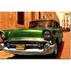 This ready to hang, gallery-wrapped art piece features a 1957 Chevy Bel Air. Masters Fine Art is a company that travels around the world to bring the best in fine art from outstanding artists from dif