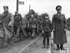 German POWs.  Note the very young solider.