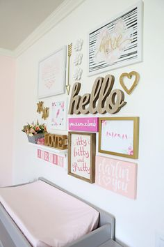 This is the most precious gallery wall for over a changing table!
