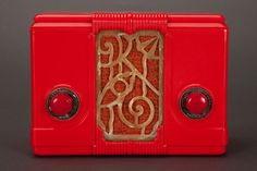 """Incredible Chinese Red Plaskon Kadette """"Jewel"""" Model 44 with a marbled Tenite Art Deco grill insert. This tube radio was manufactured in 1935 by the International Radio Corp. in Ann Arbor, Michigan."""