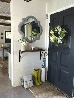 Foyer - styled w/ an umbrella & stand + some chartreuse green boots and a matching floral wreath & florals in a vase on the shelf