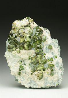 A super specimen of lustrous Demantoid Garnets from the classic Italian location around Dossi di Franscia, Lanzada, Lanterna Valley, Italy. Crystal Classics Minerals                                                                                                                                                                                 More