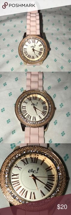 New. ETC. Beautiful Watch Light Pink Silicone Band. Gold face with stones like diamonds around it. Absolutely Beautiful Watch. Band is adjustable to fit. etc! Accessories Watches