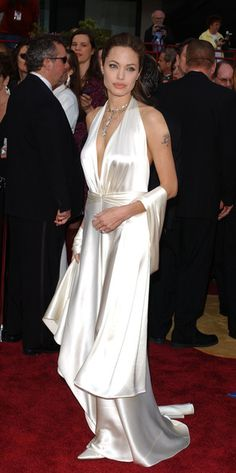 Angelina Jolie was white hot at the Oscars for one of her most memorable red carpet moments in a deep-plunging satin Marc Bouwer gown.