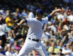 Chris Rusin #18 of the Chicago Cubs pitches against the Pittsburgh Pirates in the first inning on September 14, 2012 at Wrigley Field in Chicago, Illinois.  (September 13, 2012 - Source: David Banks/Getty Images North America)