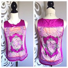"""FASHION paisley prints satin sleeveless top Bust: 34""""-36 Waist: free Length: 22""""  97% poly 3% spandex  Stunning silky finish blouse with gorgeous modern runway prints. Sophisticated and elegant.   TAGS INDICATE XS BUT MEASURES A SMALL. Posted with eBay Mobile 212 Tops"""