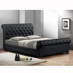 Traditional button-tufting and a timeless sleigh bed design are updated and modernized, resulting in this sleek, contemporary bed. The full size Leighlin Designer Sleigh Bed is madewith buttery smooth matte black faux leather and underlying foam padding.
