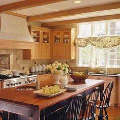 oak cabinets, not too 80s-ish.  Maybe the stone or limestone backsplash helps?
