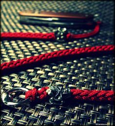 Mini Jester skull bead on red two-peg spool knit lanyard