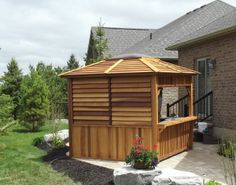 Red Cedar Gazebo Kit - This gazebo is the perfect choice for those who want a complete roof over their spa, hot tub, or sitting area yet still enjoy their natural surroundings.