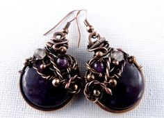 Many Blessings -  Amethyst Earrings: The eclectic forms of these earrings combines the contrasting Violet of the Natural Amethyst with the warmth of the copper. Let these wonderful earrings bring the majesty of a blessed perspective of life. Let them serve as your reminder to maintain an open spirit and allow life to work its' magic! Handcrafted by SkyAndBeyond,