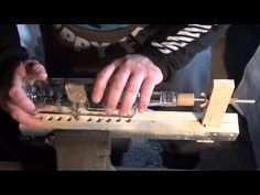 this video is of a bottle cutter i made to cut bottles 00:22 cuts broom handle and attaches to threaded bar 00:40 sands broom handle to a point 01:15 glues b...