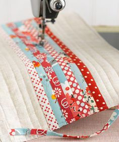 Patchwork Sewing Machine Cover..would love to make a scrap quilt like this...large white or solid color strips between scrap strips...