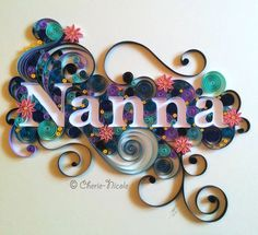 A personalised quilling piece with blue, purple and pink tones.