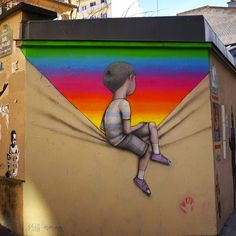 Seth Globepainter's murals revive bland walls with vibrant images of children immersed in galaxies of color