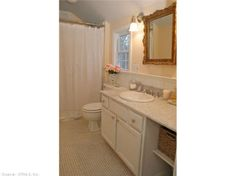 Bright bathroom with hexagon floor tile and carrera marble vanity. Find this home on Realtor.com
