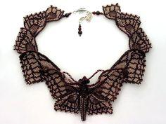 Bead art by Huib Petersen. Multi-winged Butterfly
