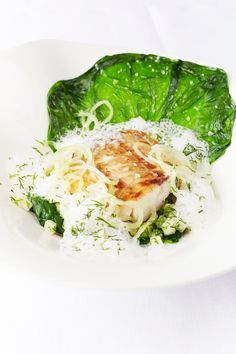 Pan-fried sea bass fillet and mousseline raviolo, steamed lettuce and cucumber by Will Holland