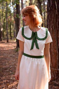 Cute in a nutshell: a crisp white & pine green vintage frock.