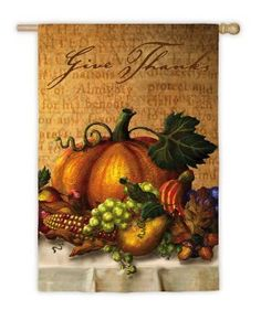 """Autumn Fall Harvest Give Thanks Table Thanksgiving Garden Flag 18"""" x 12.5"""" by Evergreen. $19.99. Thanksgiving FlagItem #141S836Create a vibrant harvest ambiance on your front patio with this Thanksgiving garden flagFeatures a Thanksgiving dining table with an overflowing of harvest treats such as pumpkins, corn, pears, grapes and apples Flag reads """"Give Thanks""""Dimensions: 18""""H x 12.5""""WMaterial(s): polyesterNote: Flag only, flag stand not included. Save 20%!"""