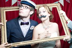 Photo booth at your wedding with a backdrop & fun props to keep your guests entertained while you do your photos!