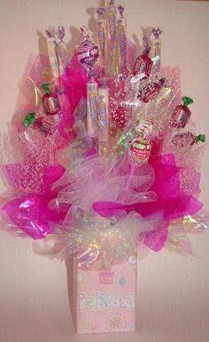 Doesn't it feel great to do something nice for someone special? If you have a friend, relative, or coworker who has a sweet tooth, con. Candy Arrangements, Candy Centerpieces, Disney Candy, Cookie Bouquet, Gift Bouquet, Candy Boutique, Candy Cakes, Chocolate Bouquet, Gift Cake