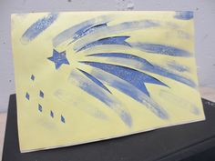 Star in your life deserves a star art card...hand painted, hand carved design with periwinkle paint....yellow cardstock