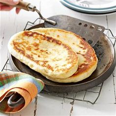 Bread Machine Naan Recipe -Chewy yeast-raised flat bread is a snap to make in a bread machine. Serve naan with your favorite Indian dish to soak up the curry and sauces.—Shannon Ventresca, Middleboro, Massachusetts