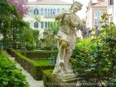 Flute playing garden statue at Venetian palazzo | The Decorating Diva, LLC #blogtourmilan #venice #gardens
