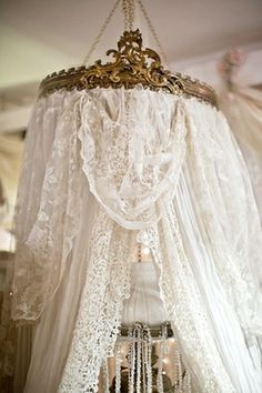 Bed crown with lace curtains