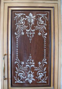 Stenciled kitchen door panel- I'm thinking white background and black stencil or even white background with baby blue stencil!