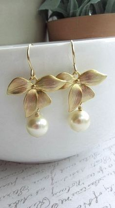 Orchid Flower Earrings . etsy.com reminds me of some ruby flower dangle earrings I had once... These are pretty n classy...