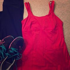 lululemon tank Amazing bright red double-strap tank by lululemon athletica. Sweat wicking technology & built in bra. Built in pockets for optional removable bra cups (not included) & adjustable bra sizing on inside. Double strap is super cute detail. In excellent used condition. Size 10. Re-posh for me, didn't fit. lululemon athletica Tops Tank Tops