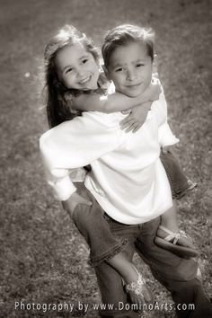 Beautiful portrait of a brother and his little sister by Domino Arts Photography (www.DominoArts.com)
