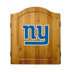 This NFL New York Giants Wooden Dartboard Cabinet Set is made of solid  pine and makes a great gift for the sports fan in your life. This  officially licensed dartboard comes with mounting hardware and six team  logo darts.   Great gift for sports fan Perfect for man cave or garage Made by Imperial International Solid pine wood dartboard cabinet All natural 18-inch bristle dart board Mounting instructions and hardware included Six steel darts with team logo on flights Includes chalk and ...