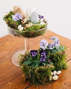 Easter home decor, using dessert glasses and moss, quails eggs and pansy flowers