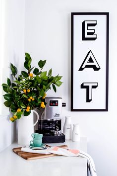 EAT banner from Hunting for George. Perfect for the kitchen! http://www.huntingforgeorge.com/homeware/prints/eat-print