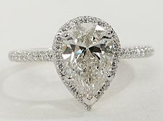 Beautifully designed, this diamond engagement ring showcases micropavé-set…