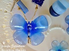 plastic bottle Butterfly- I like this version too-- Did it. It is HARD to cut through the middle of the bottle bottom.