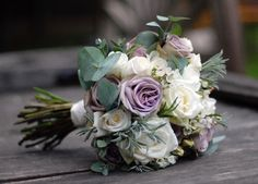 Bridal bouquet of amnesia and avalanche roses with eucalyptus and lavender foliage. Leigh Chappell